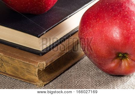 Detailed Close-up View Of The Red Apples And Old Vintage Book