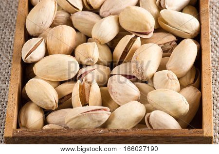 View Close-up On Pistachios In A Wooden Box