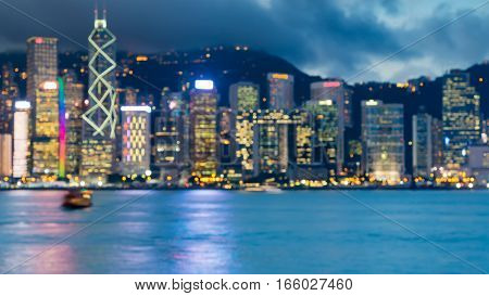 Blurred lights Hong Kong business downtown over Victoria Bay night view