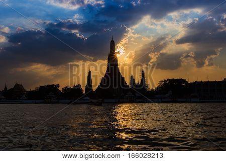 Wat Arun at sunset with Silhouette view river front Bangkok Thailand Landmark