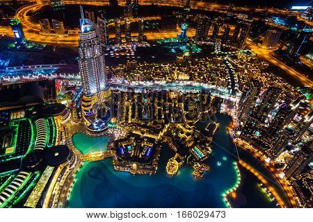 Cityscape of dubai at night with illuminated buildings and streets.