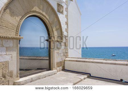 Mediterranean sea reflected in a window. Sitges, Spain