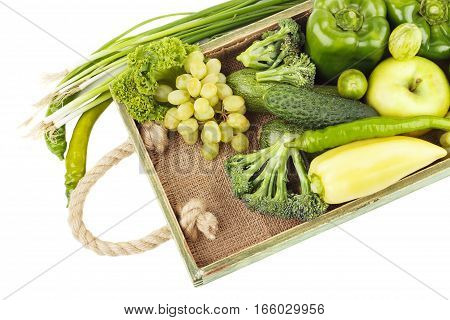 Set Of Green Raw Vegetables And Fruits In The Wooden Tray, Isolated