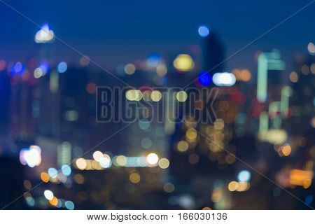 Nights blurred bokeh lights office building abstract background