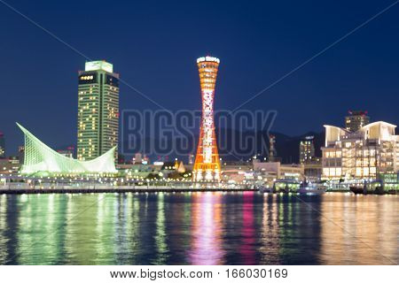 Twilights sky background blurred lights Kobe port tower with water reflection