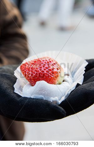 mochi filled with red bean paste and topped with giant strawberry
