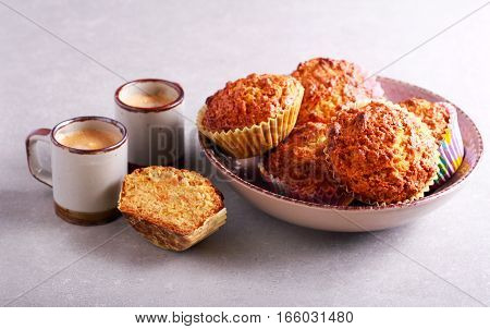 Carrot and apple muffins with raisin and nuts and coffee
