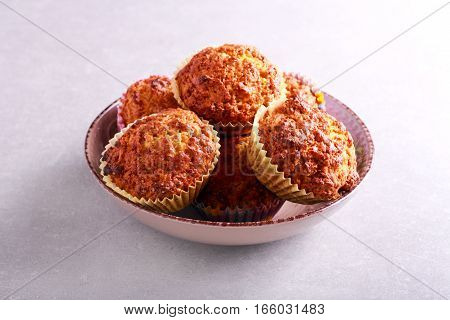 Homemade muffins in a bowl on table