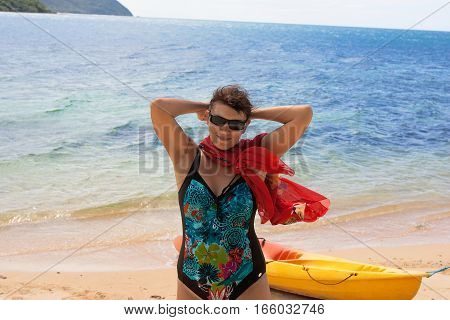 woman on the beach with a kayak