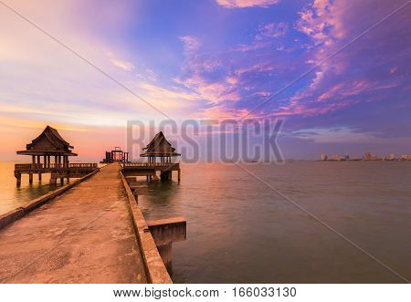 Walking way leading to ocean with beauty of after sunset sky background