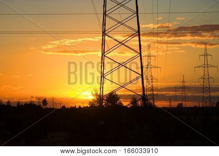 hight vottage line sihouette. orange sunlight background