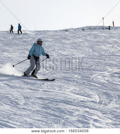 Mont Joux France- December 292014: Unidentified woman skiing on a in Mont Joux in Beaufortain Massif in Haute-Savoie close to Mont Blanc Massif.