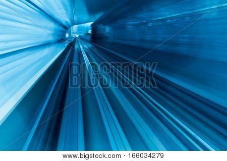 Motion blurred train moving into tunnel abstract background