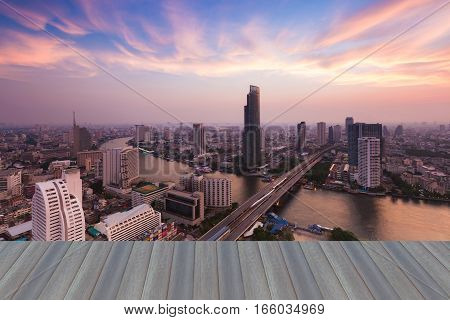 Openig wooden floor city and river aerial view with beautiful sky after sunset Bangkok Thailand