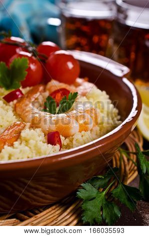 Couscous with shrimp and vegetables. Selective focus.