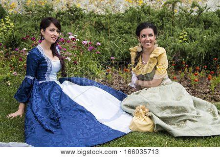CAGLIARI, ITALY - June 1, 2014: Sunday at La Grande Jatte public gardens - Sardinia - portrait of beautiful women in Victorian costumes