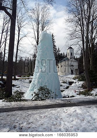 frozen fountain in the park and church, Czech Republic, Europe