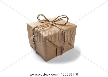 Box with a gift wrapped in Kraft paper on a isolated white background