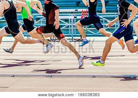 group of athletes sprinters run speed on track of stadium