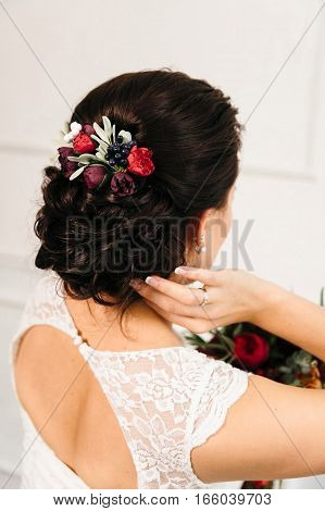 beautiful work of a hairdresser: hairstyle for long hair - stacked curls and decorated with flowers