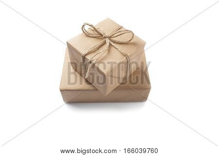 Two boxes with gifts wrapped in Kraft paper on a isolated white background