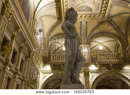 VIENNA, AUSTRIA - JANUARY 2 2016: Luxury classic interiors of Vienna Opera House with statue in the foreground