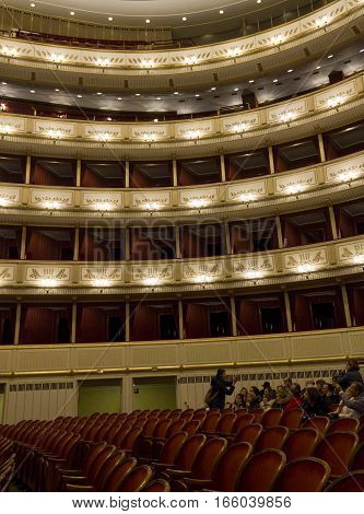 VIENNA, AUSTRIA - JANUARY 2 2016: Interior of viennese Staatsoper Vienna opera house with people seat on the chairs