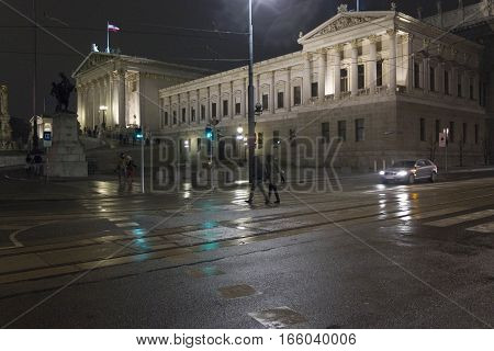 VIENNA, AUSTRIA - JANUARY 2 2016: Night view of Vienna Parliament lighted with green traffic jam