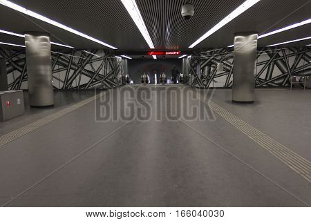 VIENNA AUSTRIA - JANUARY 2 2016: Vienna undergound station U1 red line with just one person in the background