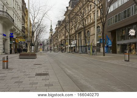 VIENNA, AUSTRIA - JANUARY 3 2016: Day view of Mariahilferstrass in Vienna in winter season with bare trees and very few people around