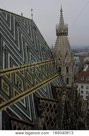 VIENNA, AUSTRIA - JANUARY 3 2016: Architectural close up of the roof and Steeple of Stephansdom cathedral from its top in Vienna Austria