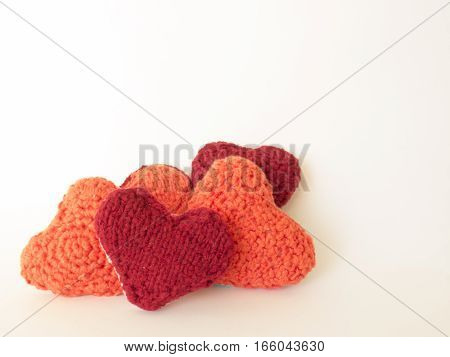 Background of wool red and orange  hearts handmade
