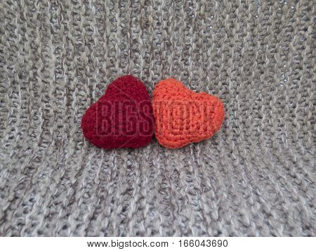 Two Hearts Connected From The Wool On A Grey Background
