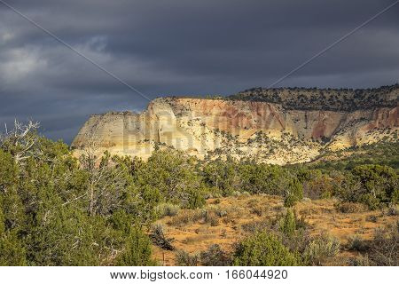 Storm Clouds Forming Over A Rock Butte In Utah