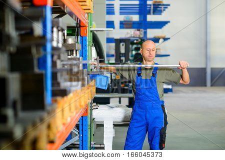 one worker in factory in stockroom working