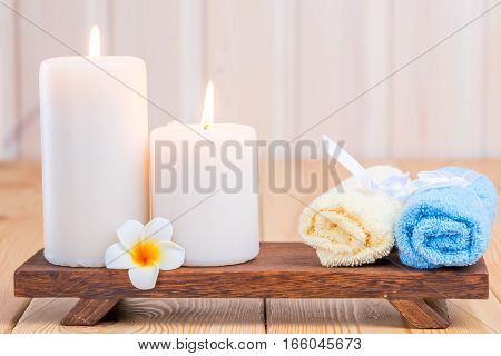 Towels And Burning Candles Close-up Still Life With Frangipani