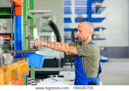 one worker in factory in stockroom working