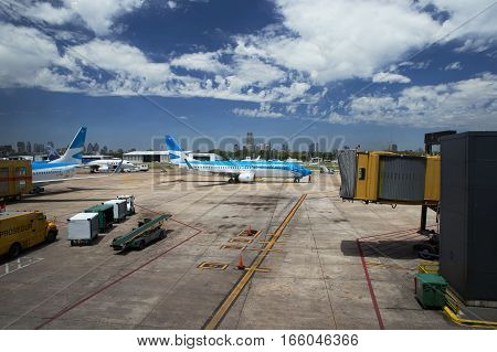 MENDOZA, ARGENTINA - DEC 6, 2016: Aircraft and ground vehicles manoeuvre on the tarmac at Mendoza Airport.
