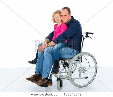 disabled man in weelchair with his daughter in front of white background