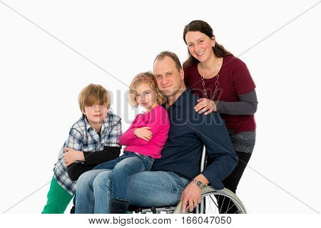 Disabled Man In Weelchair With His Family