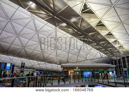 Hong Kong, China - Oct 30, 2016: Inside Hong Kong International Airport - South side dinning area. Image features modern architectural designs with an exclusive Rolex Watch Store.