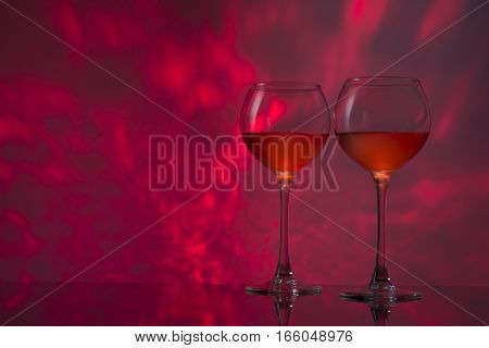 Romantic red design with glasses of wine.