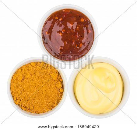 Three Bowls With Ketchup, Cheese Sauce And Turmeric