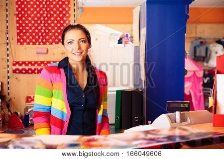 Friendly female sales person at children's store