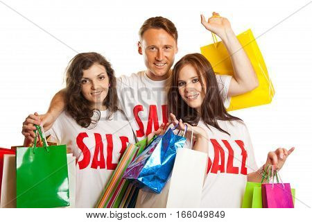 isolated studio shot of three young people enjoying a sale event.