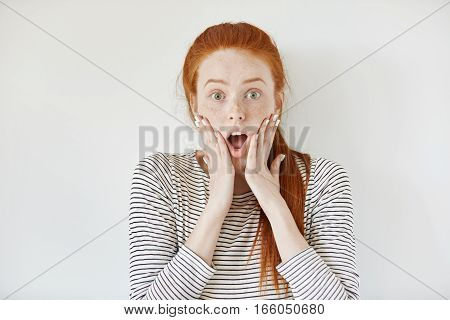 Human Face Expressions And Emotions. Redhead Young Female With Freckles And White Nails Screaming Wi