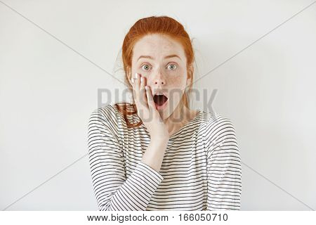 Surprised Astonished Teenage Girl Wearing Sailor Shirt Touching Her Cheek And Keeping Mouth Wide Ope