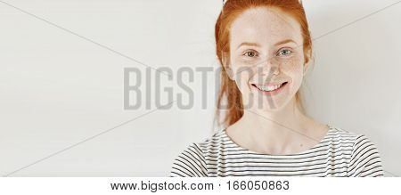 Heterochromia Concept. Attractive Young Woman With Ginger Hair And Different Colored Eyes Smiling Ha