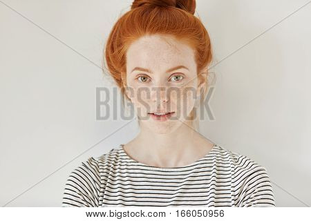 Beauty And Skin Care Concept. Close Up Isolated Shot Of Cute Stylish Young Redhead Woman With Freckl