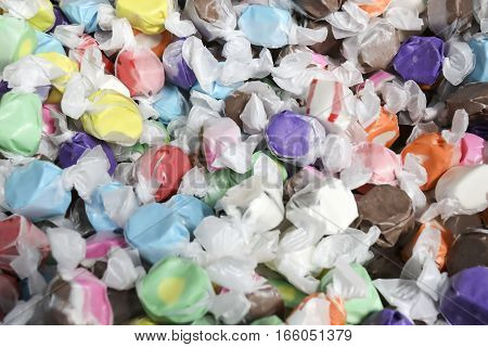 Close up of pile of colorful vintage salt water taffy candies.